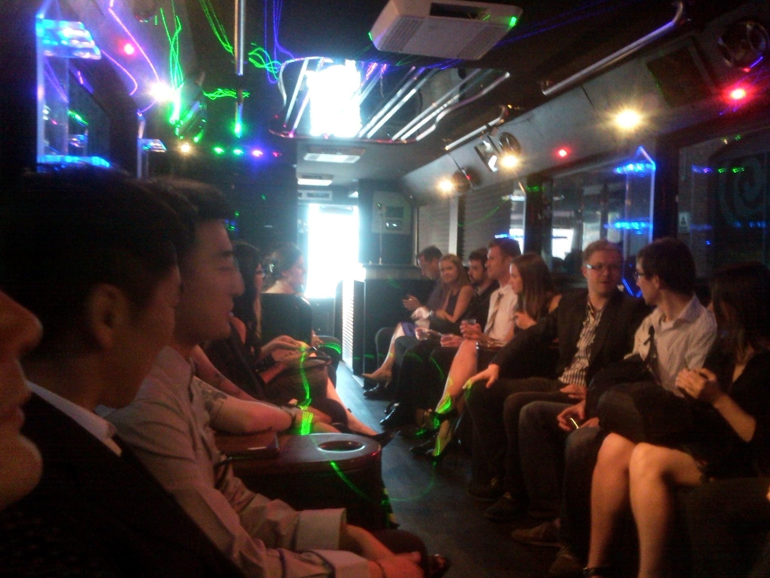 On the party bus - Evgeny and Renat chatting while we wait to get going